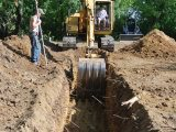 Braun Excavating, LLC - Digging a Trench for Septic Lines